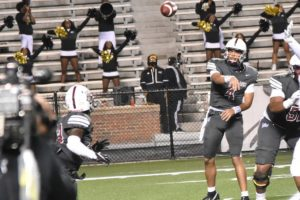 Classic Feature Offenvise MVP Aqeel Glass throws a screen pass